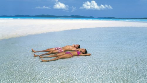 Sunbathing at whitehaven beach